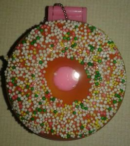 On the outside it looks just like a strawberry doughnut with yummy sprinkles all over it.