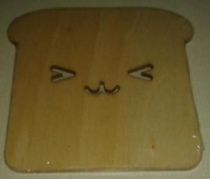 A little wooden coaster that looks like a piece of toast with a face.  Definitely kawaii!